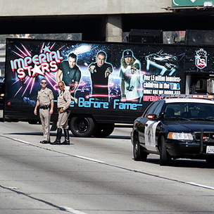 Los Angeles Rap Group Stops Traffic with Freeway Performance