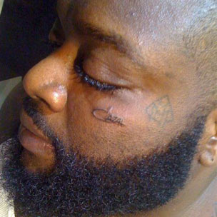 Rick Ross Gets Cazal Logo Face Tattoo