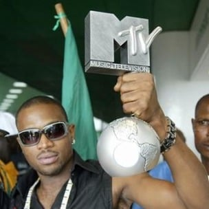 Kanye West Welcomes D'banj To G.O.O.D. Music, Awards Him His Chain