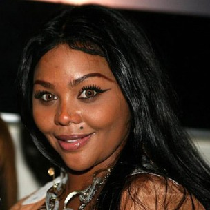 "Lil' Kim Hints At ""Big Collabo,"" Discusses Working With 50 Cent"