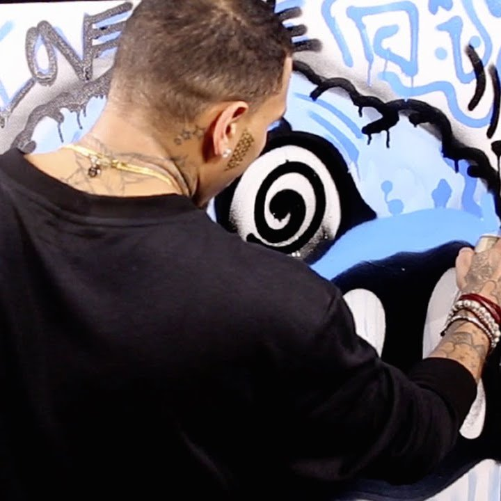 Chris Brown Paints Graffiti At Hot 97 Studios While Being