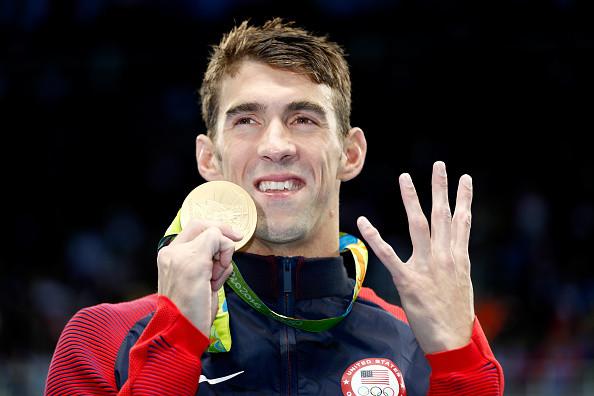 Michael Phelps Says Eminem, Lil Wayne & Steve Aoki Fueled His Intense #Phelpsface
