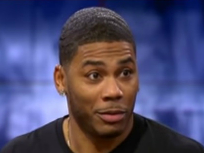 Nelly Scolds A Fan To Untie His Shoes Mid-Show