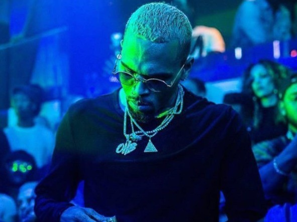 Chris Brown Served With Karrueche's Restraining Order Papers At Own Birthday Party