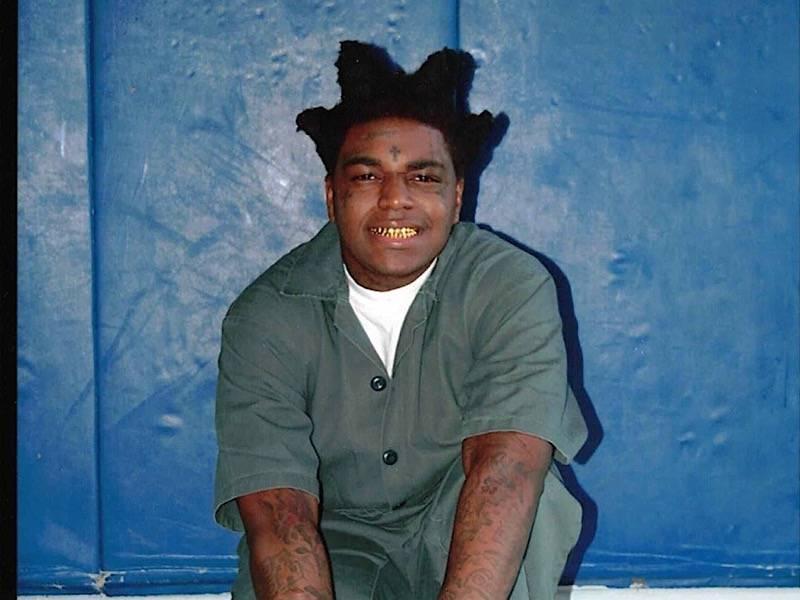 Kodak Black Cops A Smiley Squat For His Prison Photo