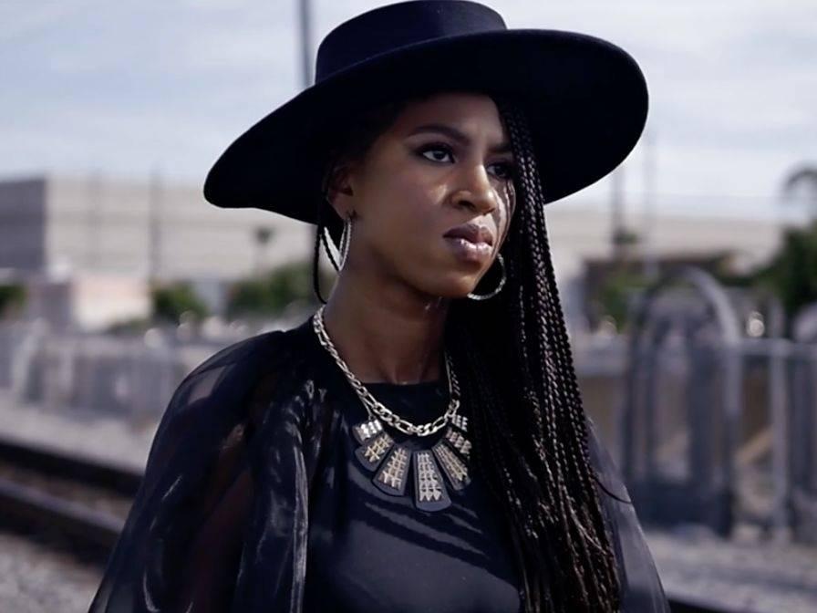 Lyric Jones Explains It All On The Railroad Tracks For 'Dusty Heart' Video